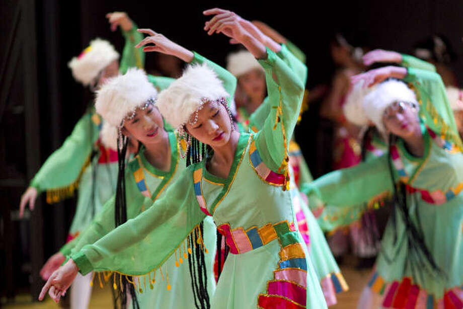 Rachel Luo, 11, of the Golden Peacock School of Dance, performs a Tibetan style dance during the 2011 Lunar New Year Festival celebrating the Chinese New Year at the Chinese Community Center in Houston. Photo: Nick De La Torre, Houston Chronicle