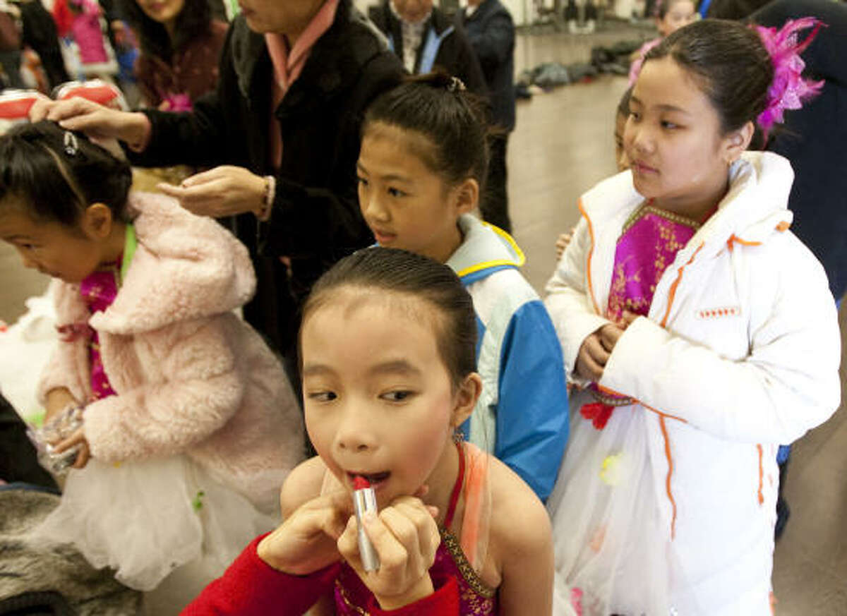 Ariana Chan, 8, of Houston, has her make-up put on as she and other Adoreyou Chinese ballerinas prepare to perform during the 2011 Lunar New Year Festival celebrating the Chinese New Year at the Chinese Community Center in Houston.