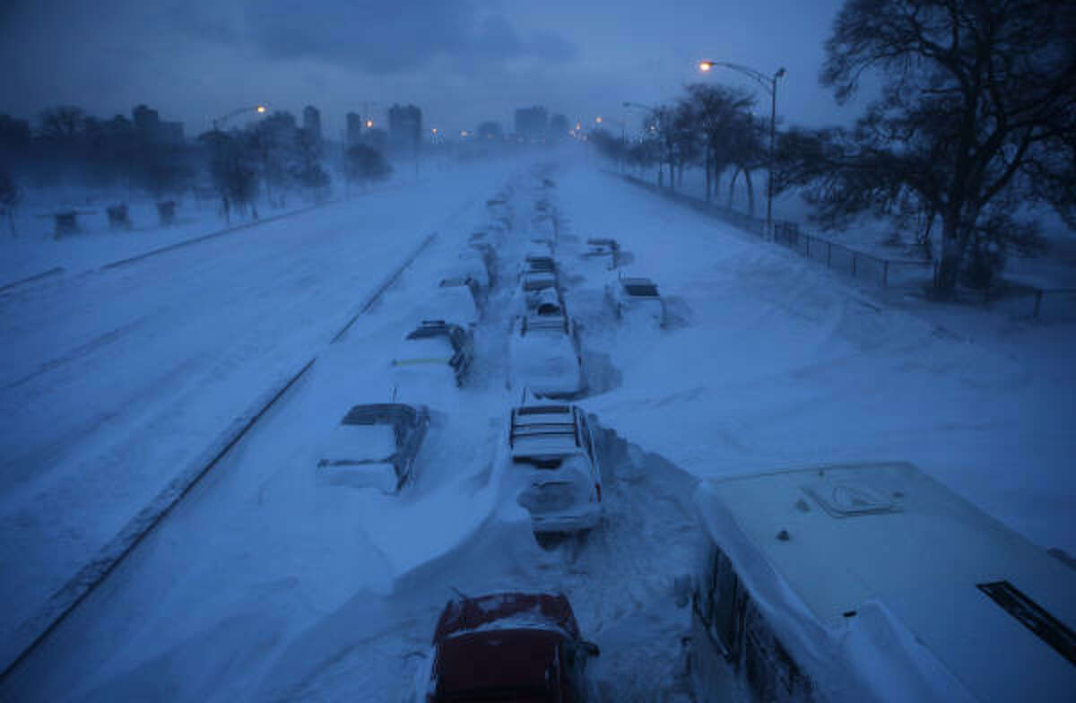 Abandoned vehicles sit along northbound Lake Shore Drive in Chicago, Illinois. There were 20.2 inches of snow at both O'Hare International and Midway airports this morning, making the Groundhog Day storm the third-largest in Chicago history, according to the weather service.