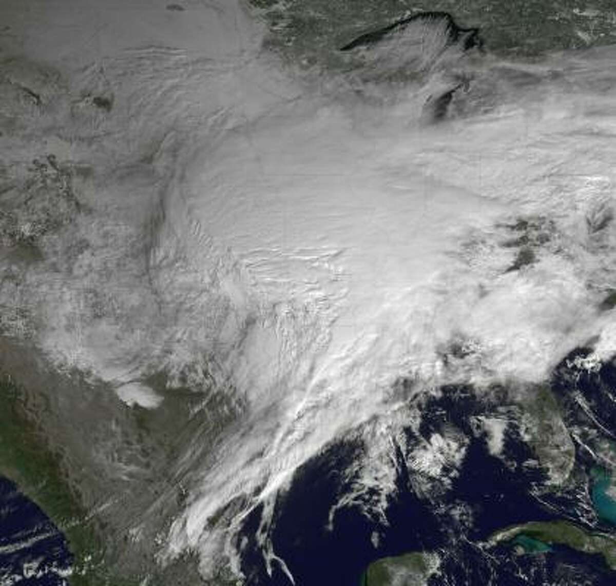 In this GOES-East satellite image from the National Oceanic and Atmosphere Administration (NOAA), a winter storm is seen as it moves across the the U.S. from space. Snow and ice have been falling across the U.S. in what is being reported as the largest winter storm in decades.