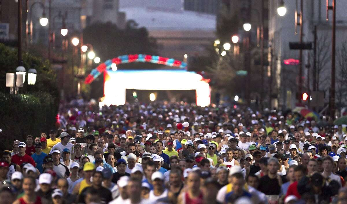 Runners head our of the start line during the Chevron Houston Marathon.