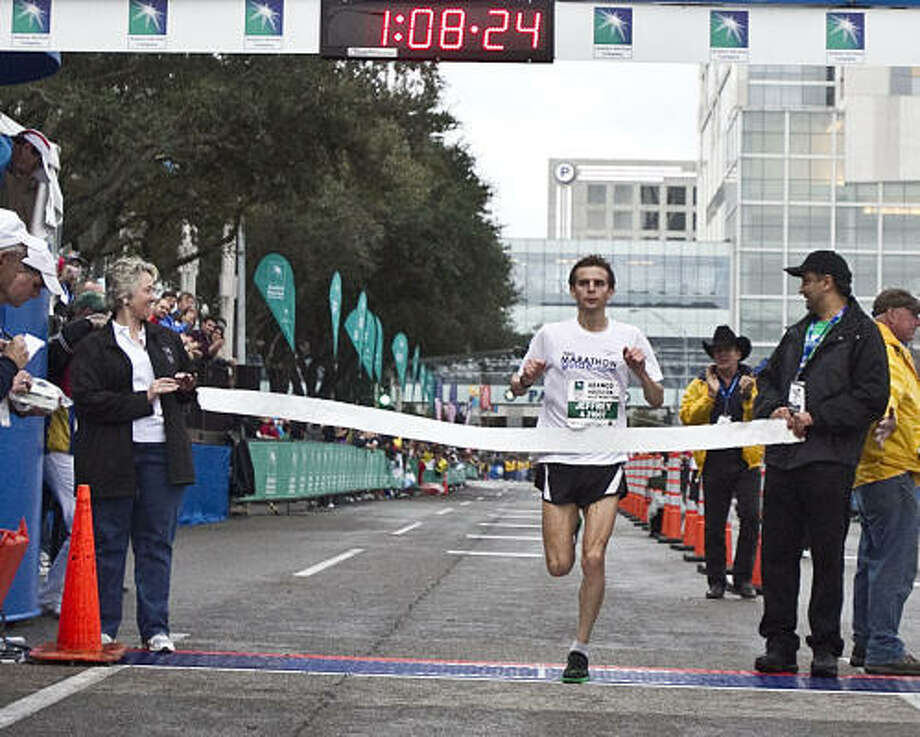 Jefferey Eggleston runs on his way to victory in the men's division of the Aramco Services Half Marathon. Photo: James Nielsen, Chronicle