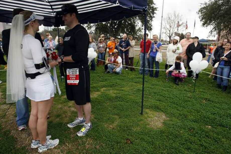 Roman Rabourn and Melissa Manson say their vows during a short wedding ceremony. Photo: Johnny Hanson, Chronicle