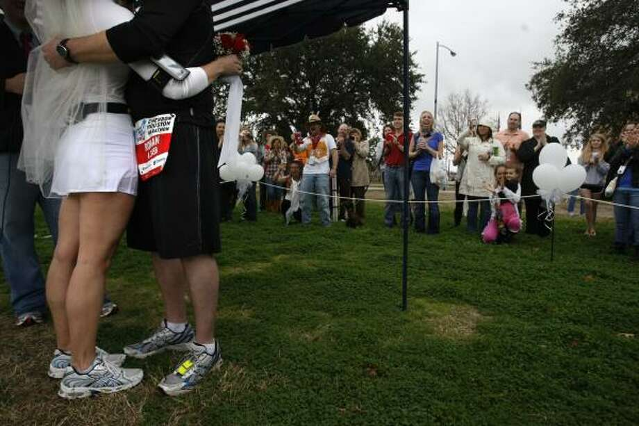 Sharing their first kiss as a married couple, Roman Rabourn and his wife Melissa Rabourn (formerly Manson) were married during a short ceremony with family and friends in Eleanor Tinsley Park. Photo: Johnny Hanson, Houston Chronicle