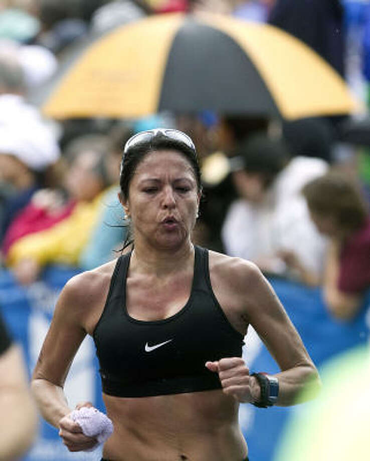 "Raquel ""Rocky"" Proctor exhales as she closes in on the finish line. Photo: James Nielsen, Chronicle"