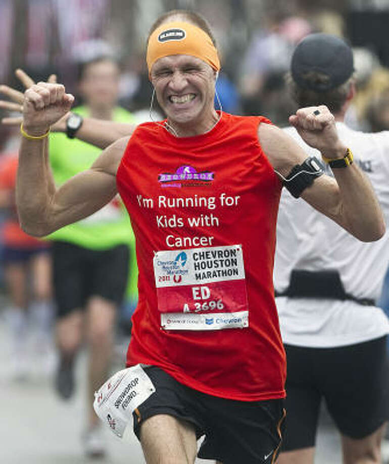Ed Barsingerhorn pumps his fists after finishing. Photo: James Nielsen, Chronicle