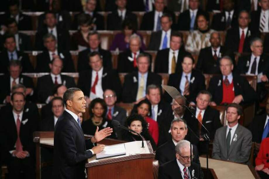 President Barack Obama addresses a joint session of Congress while delivering his State of the Union speech Tuesday. Photo: Brendan Smialowski, Getty Images