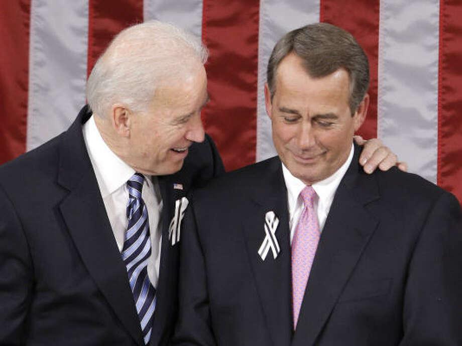 Vice President Joe Biden talks with House Speaker John Boehner, R-Ohio, prior to the start of President Barack Obama's State of the Union address. Photo: Charles Dharapak, AP
