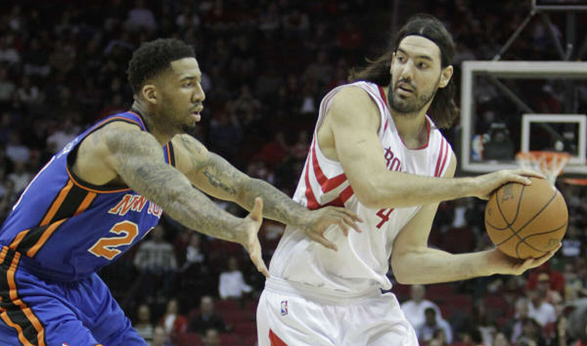 Rockets 104, Knicks 89 Rockets forward Luis Scola, right, tries to pass the ball around Knicks forward Wilson Chandler during the first half of Wednesday's game at Toyota Center.