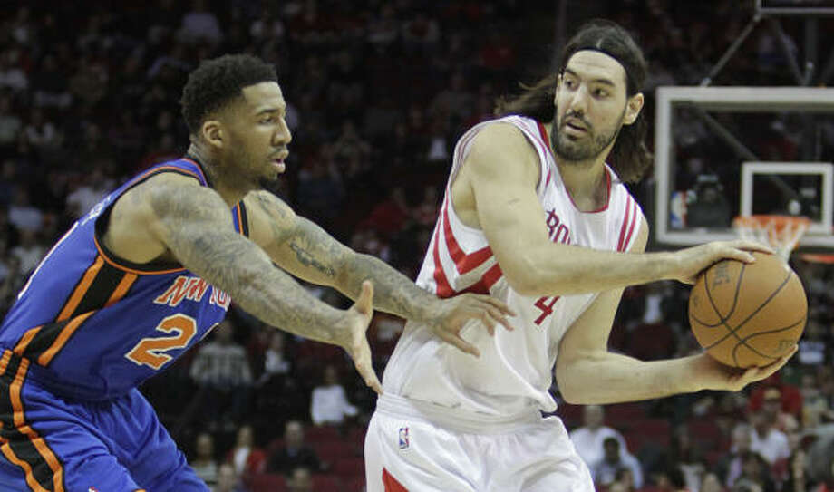 Rockets 104, Knicks 89Rockets forward Luis Scola, right, tries to pass the ball around Knicks forward Wilson Chandler during the first half of Wednesday's game at Toyota Center. Photo: Karen Warren, Chronicle