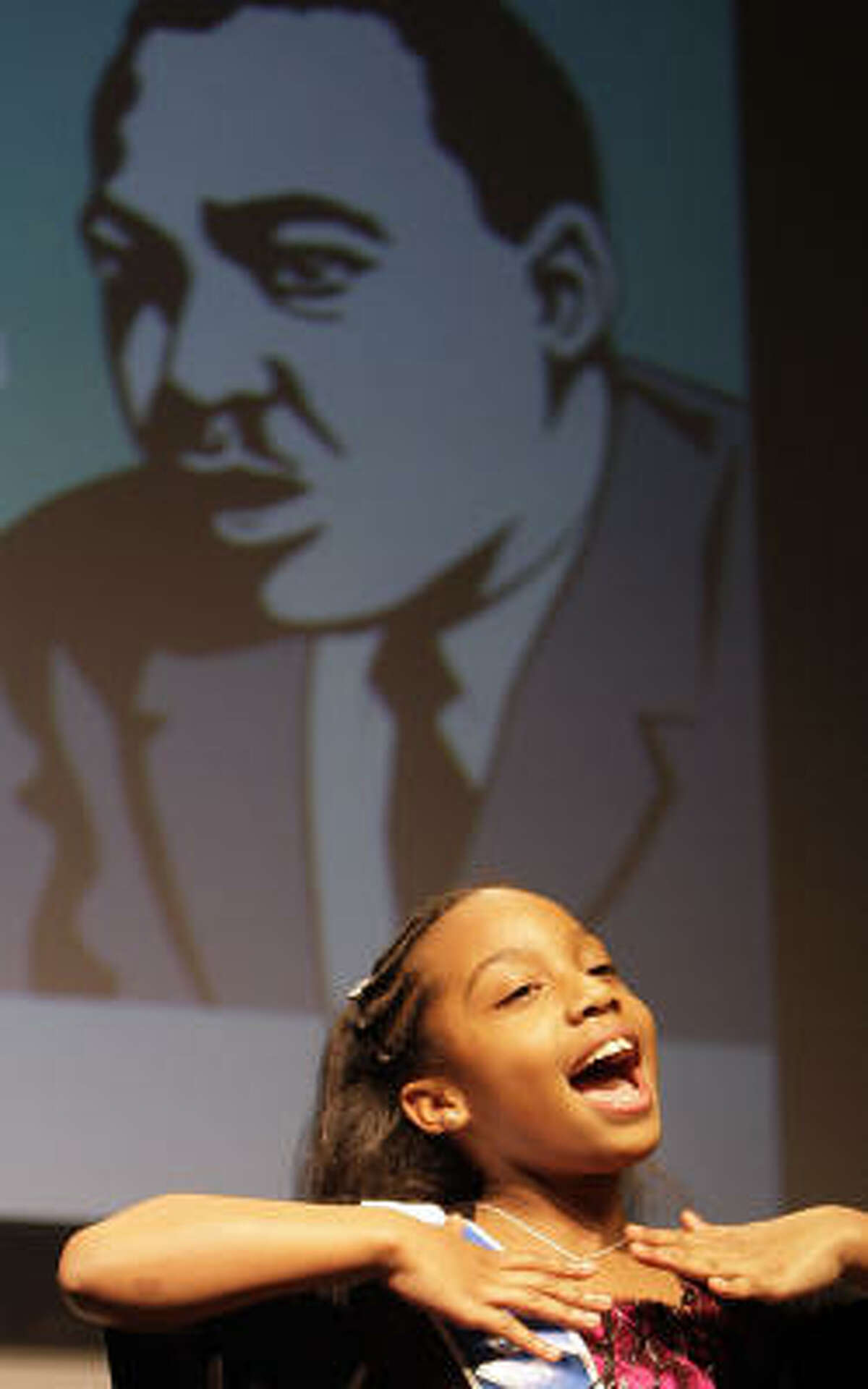 Gardere Oratory Competition winner ten-year-old Morgan Hunter recites her speech during the MLK Day Peace Rally at the Children's Museum of Houston.
