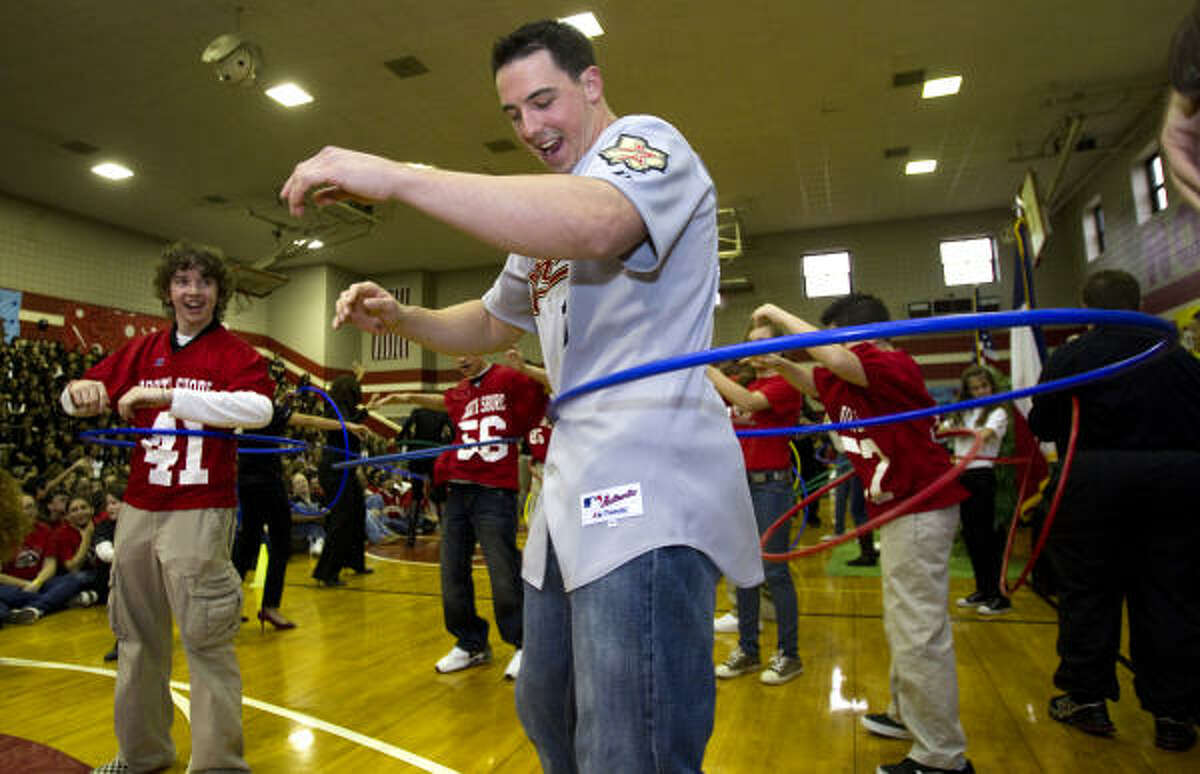 Houston Astros outfielder Brian Bogusevic participates in a Hula Hoop contest with the students at North Shore Middle School, including Juan Arizpe (41), as the Astros Caravan visited the school for a pep rally to promote reading.