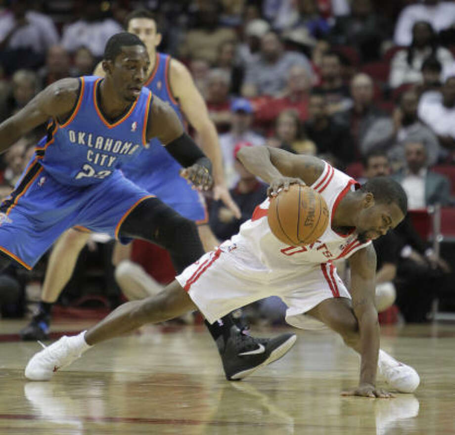 Jan. 12: Thunder 118, Rockets 112 Rockets guard Aaron Brooks stumbles with the ball in midcourt as Oklahoma City's Jeff Green looks on during the second half. The Rockets rallied late but were unable to complete a comeback. Photo: Karen Warren, Chronicle