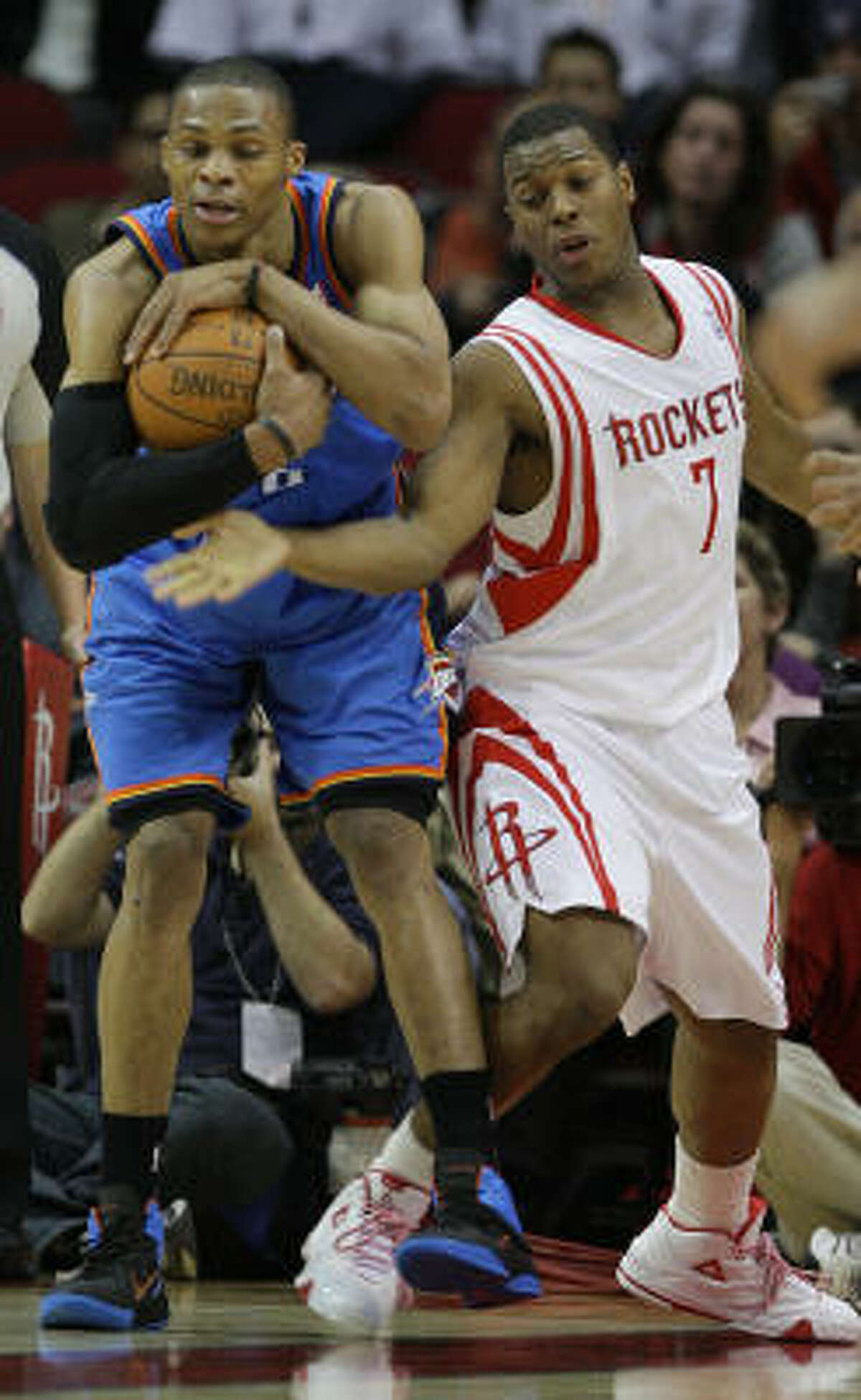 Thunder guard Russell Westbrook secures a rebound from the reach of Rockets guard Kyle Lowry during the second half.