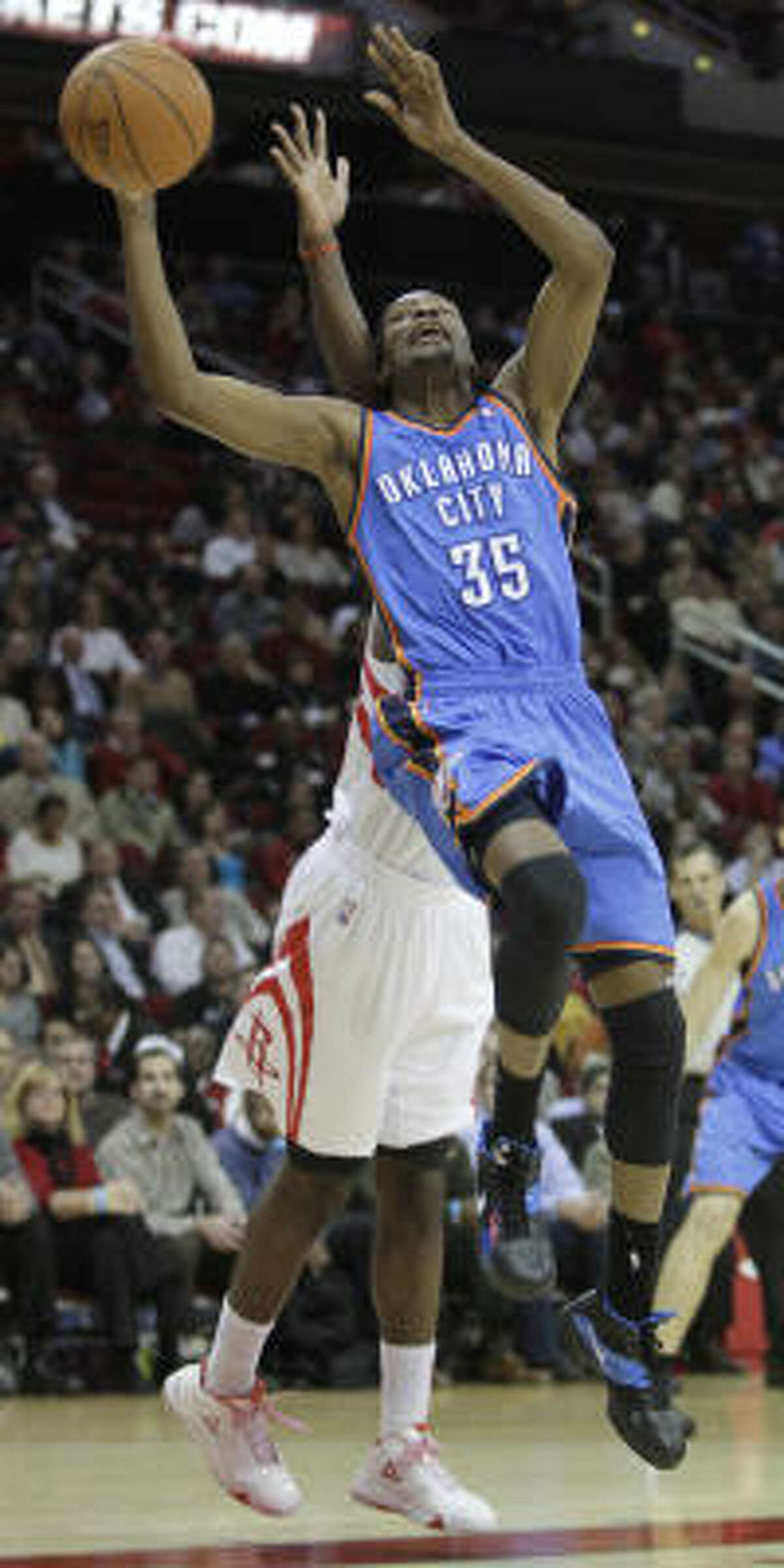 Thunder forward Kevin Durant goes up for a basket during the second half.