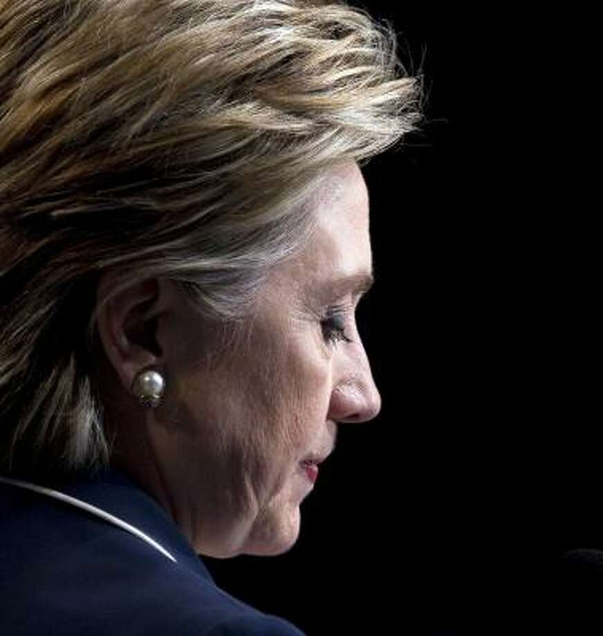 While Hillary Rodham Clinton is out of the race, she could retain delegates to pursue key issues and continue to raise money to pay off debts, or she could withdraw completely. Photo: CHUCK KENNEDY, MCCLATCHY TRIBUNE