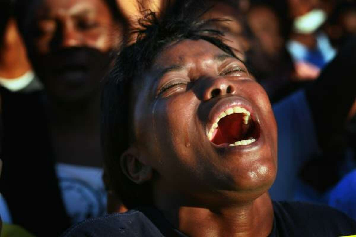 A woman cries as she attends a prayer service in memory of those killed one year to the date of the massive earthquake that jolted the city in Port-au-Prince, Haiti. The Haitians remembered the date with prayer services and other events in memory of the estimated 300,000 people that were killed last year.