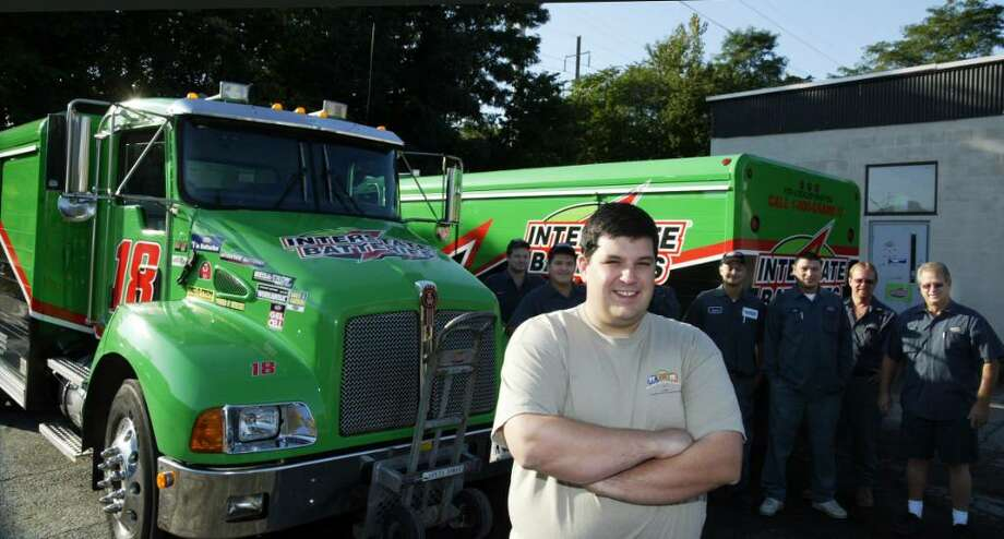 One of Interstate Batteries' youngest distributorship owners, Larry Judge, meets with his drivers, after loading their trucks for the days delivery's from Judge's Fairfield Distributorship on Commerce Drive, Tuesday, Sept. 29, 2009. Photo: Phil Noel / Connecticut Post