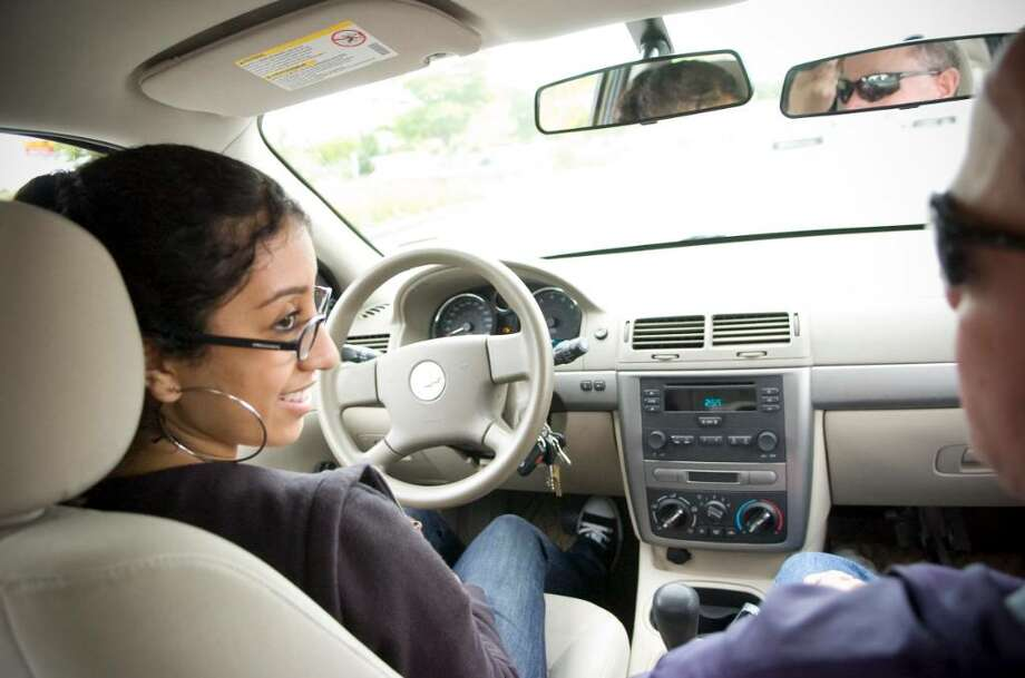 Reema Malhotra, 17, practices driving with  Ron Occhin, of High Ridge Driving School, in Stamford, Conn. on Wednesday, Sept. 30, 2009. Photo: Chris Preovolos / Stamford Advocate
