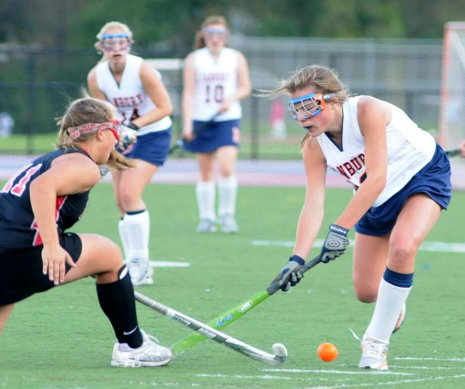 Stacey Dileo, #11, of Warde High School in Fairfield, CT, trys to steal the ball from Danbury High School's Hannah Keiser, #13, at the girl's field Hockey game played Thursday, Oct. 1, 2009 at Danbury High School's athletic field. Photo: Jay Weir / The News-Times