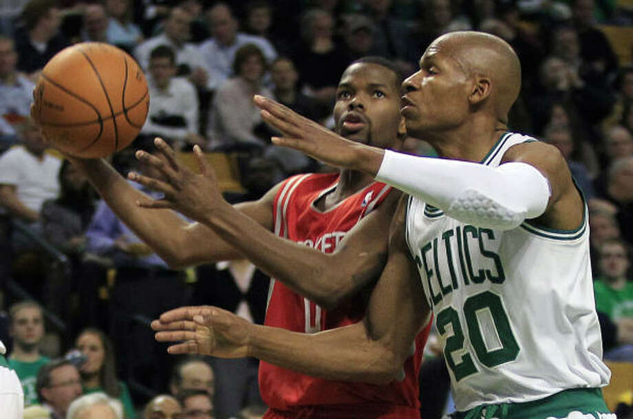 Celtics guard Ray Allen, right, tries to stop Rockets guard Aaron Brooks, left, on a drive to the basket. Photo: Charles Krupa, AP