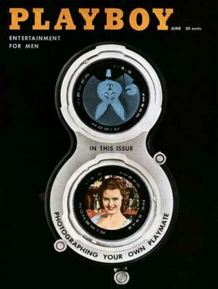 Judy Tomerline and Mr. Playboy reflected in the lens of a camera on the cover of the June 1958 issue.