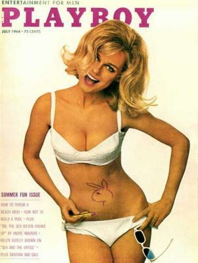 This cover of Cynthia Maddox with the Playboy logo scrawled around her bellybutton is one of the most iconic from the time period. July 1964.