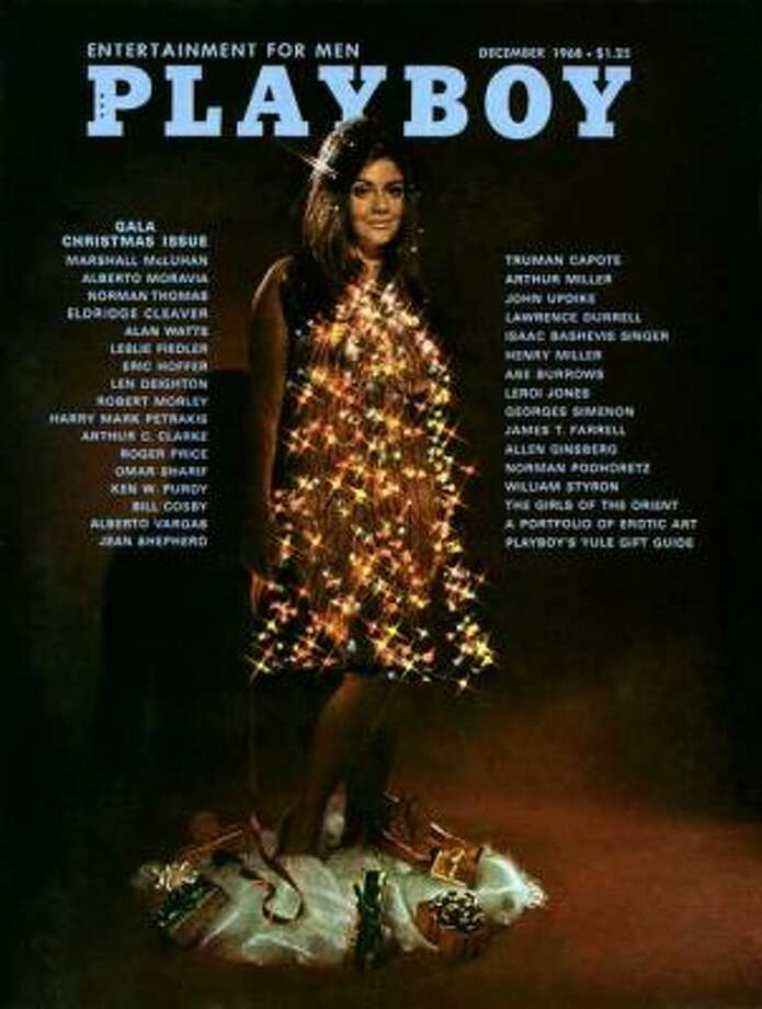 Cynthia Myers poses in one of the more bizarre Playboy cover shots for the Gala Christmas issue. December 1968.