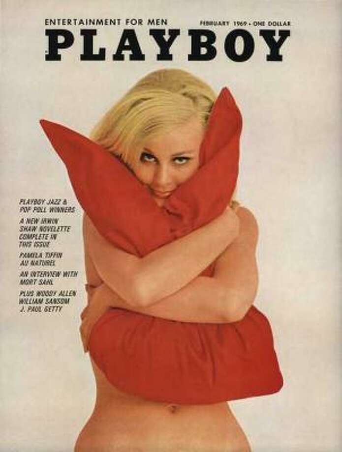 Lorrie Menconi snuggling into a pillow on the cover of the February 1969 issue.