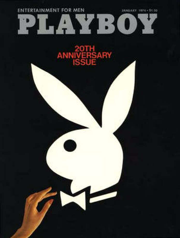 A phantom hand reaches up to the tie of the classic logo on the 20th Anniversary issue. January 1974