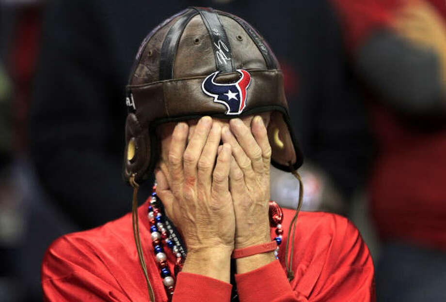 Houston Texans fan Donnie Taylor covers his eyes after the Texans were called for a penalty during the fourth quarter of an NFL football game against the Baltimore Ravens at Reliant Stadium in Houston.  The Ravens beat the Texans 34-28 in overtime. Photo: Brett Coomer, Houston Chronicle