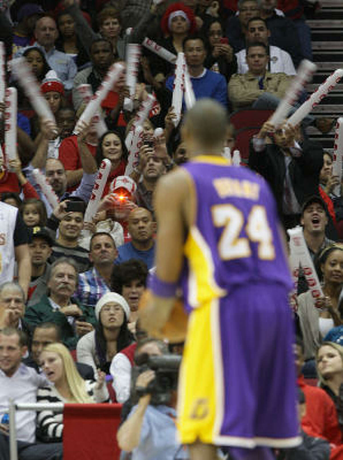 Houston fans try to distract Lakers Kobe Bryant as he shoots a freethrow during the second half of the Houston Rockets-Los Angeles Lakers MLB game at The Toyota Center in Houston. Rockets won the game 109-99.
