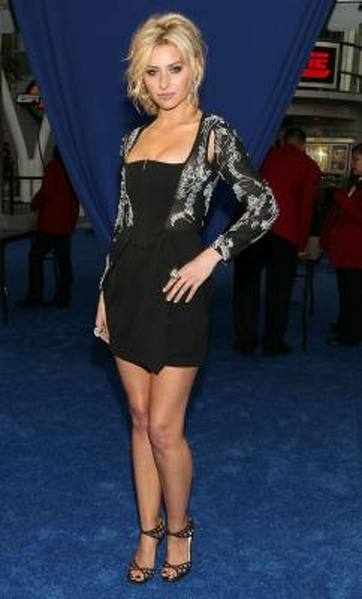 Aly Michalka. A sequined dress with an even more sequined bolero? Think knit from the '70s. Yuck!