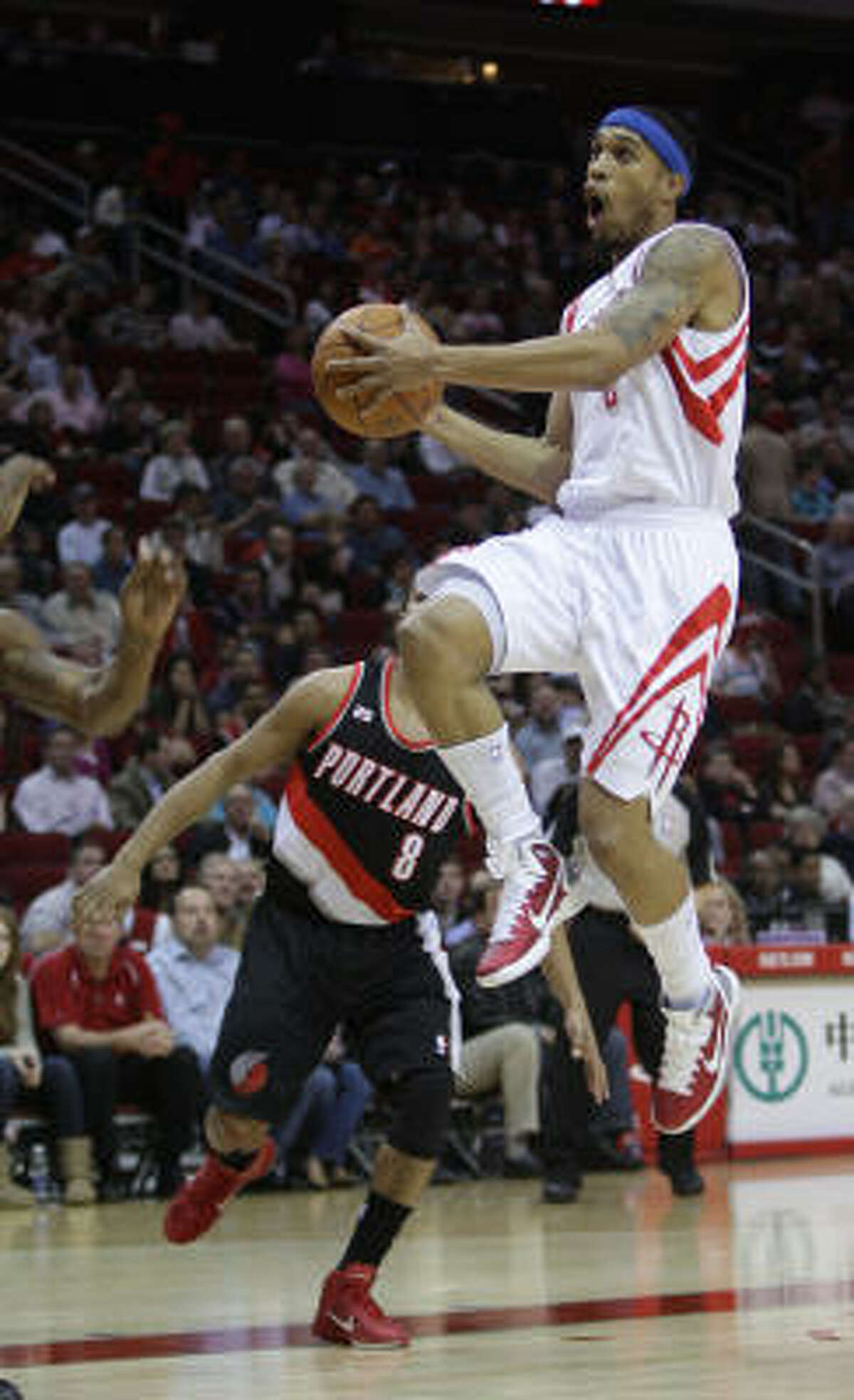 Rockets guard Courtney Lee, right, flies up to the basket during the first half.