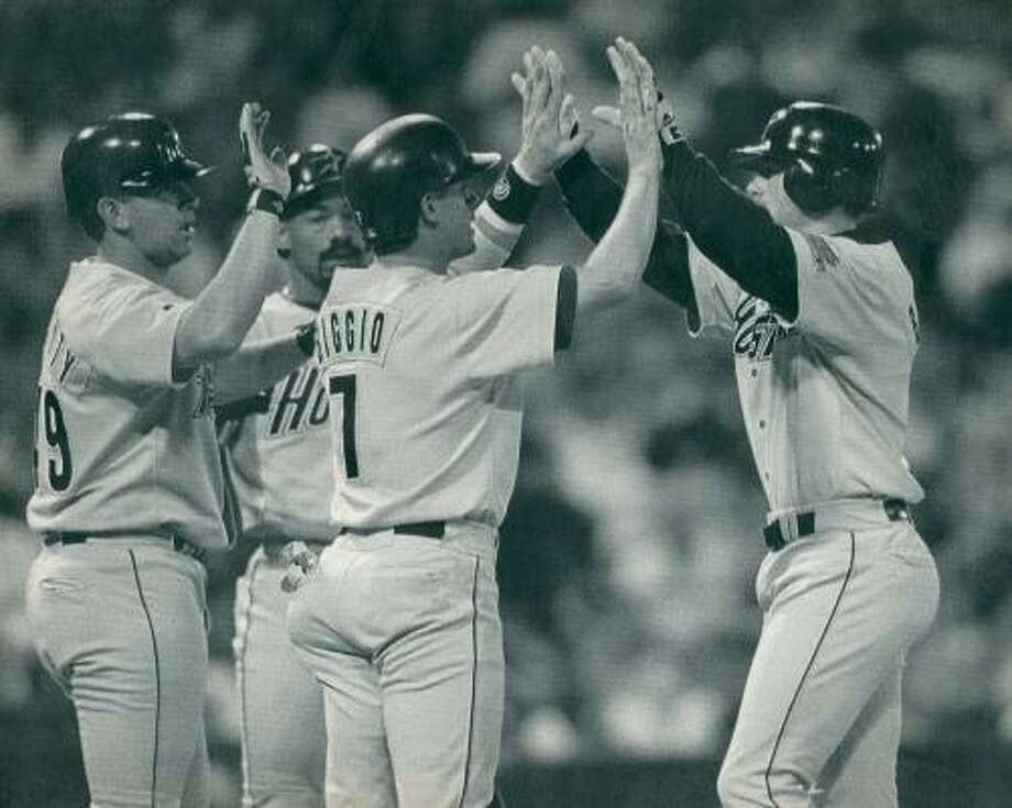 1995:Jeff Bagwell greets Craig Biggio after Bagwell's three run homer on July 14, 1995 at San Francisco's Candlestick Park. Behind Biggio, pitcher James Dougherty and outfielder Derek Bell wait for their high fives. Photo: Susan Ragan / AP