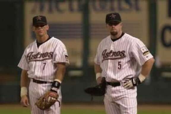 2000:  Craig Biggio (left) and Jeff Bagwell watch a pitching change take place in the fourth inning of a 2000 game against St. Louis.  Bagwell and Biggio have been teammates in Houston for 15 seasons.