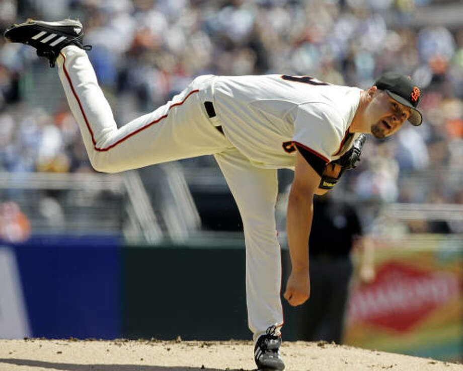 The Giants won despite a rough outing by starting pitcher Jason Schmidt, who gave up six runs on eight hits. Photo: ERIC RISBERG, AP