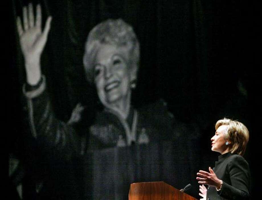 U.S. Senator Hillary Clinton eulogizes Ann Richards (pictured waving in the background) at a memorial service in Austin. Photo: REUTERS