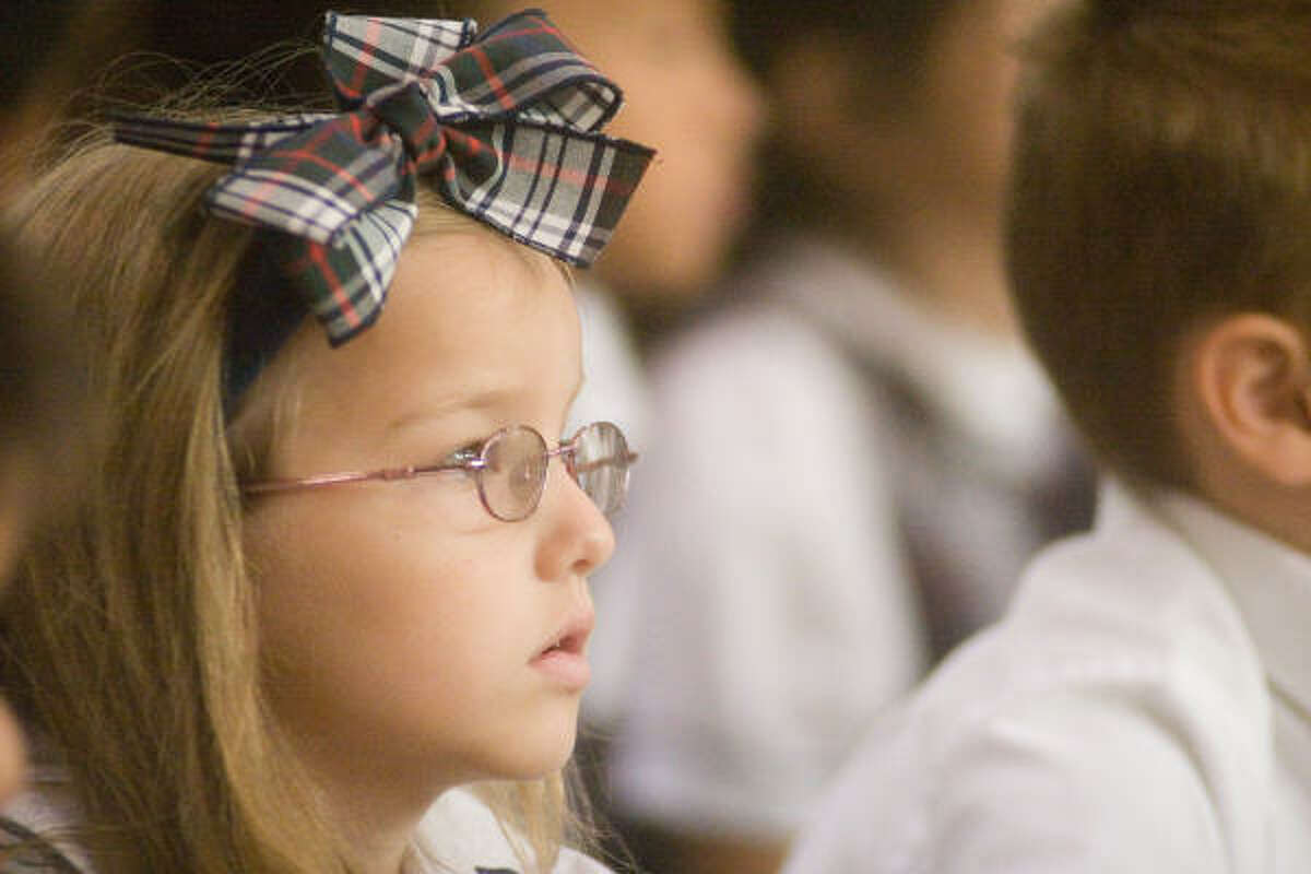 Taylor Rechter, 6, an Awty first grader, watches the goings-on at the school's 50th anniversary celebration.