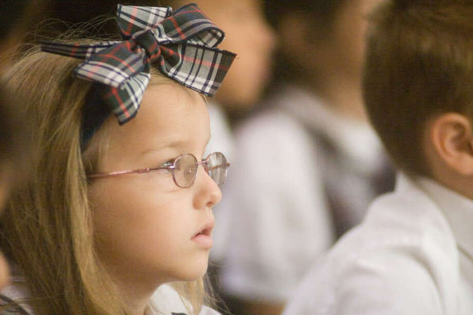 Taylor Rechter, 6, an Awty first grader, watches the goings-on at the school's 50th anniversary celebration. Photo: R. Clayton McKee, For The Chronicle