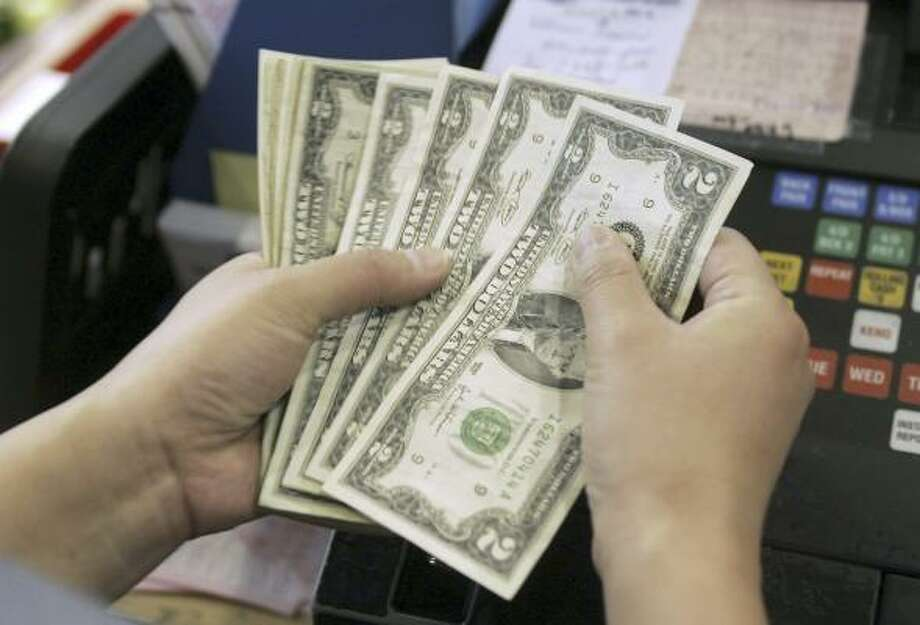 From mom and pop retailers to adult strip club owners, the $2 bill is shedding its play-money image and turning up in more and more wallets.  Photo: HYUNGWON KANG, REUTERS