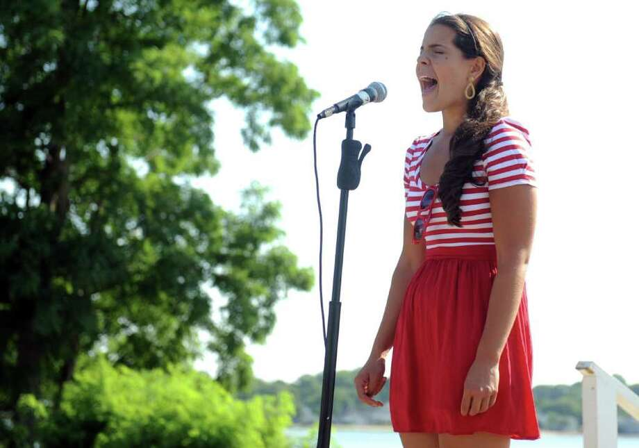 Dominique Bonessi sings the national anthem to kick off Woodmont Day Saturday, July 30, 2011 in Milford, Conn. Photo: Autumn Driscoll / Connecticut Post