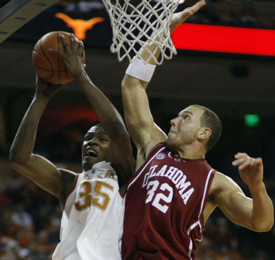 Texas' Kevin Durant, left, battles Oklahoma's Taylor Griffin while scoring 28 points in an 80-69 victory over the Sooners, a total that merely ranks as Durant's sixth-highest in Big 12 play. Photo: Harry Cabluck, Associated Press