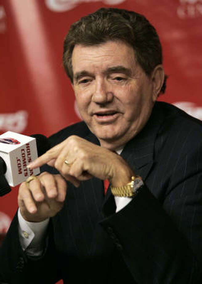 Comets coach Van Chancellor, pointing to his WNBA championship ring, can boast of being in the Naismith Hall of Fame now, too. Photo: David J. Phillip, AP