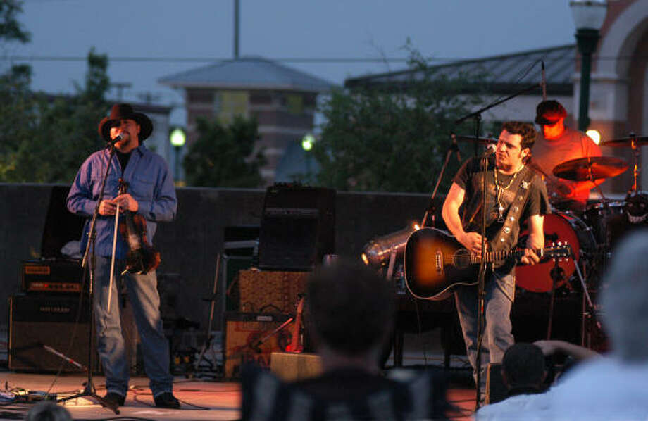 Reckless Kelly lead singer Willy Braun, right, plays guitar as brother Cody Braun performs vocals. The band returns April 5 for a concert at Heritage Place in Conroe. Photo: David Hopper, For The Chronicle
