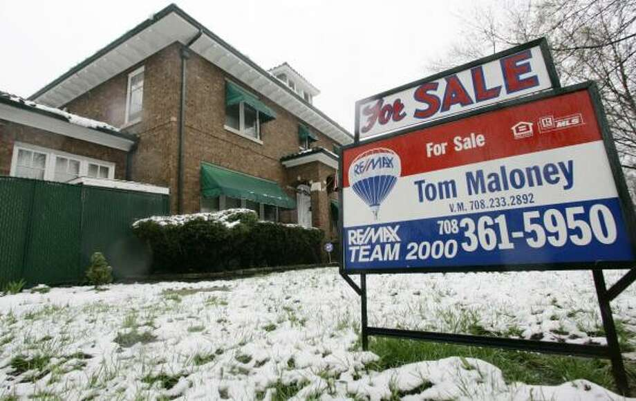 A house sports a for sale sign in Blue Island, Ill. In Washington, key senators indicated that millions in federal aid may be needed to help homeowners facing foreclosure. Photo: M. SPENCER GREEN, ASSOCIATED PRESS