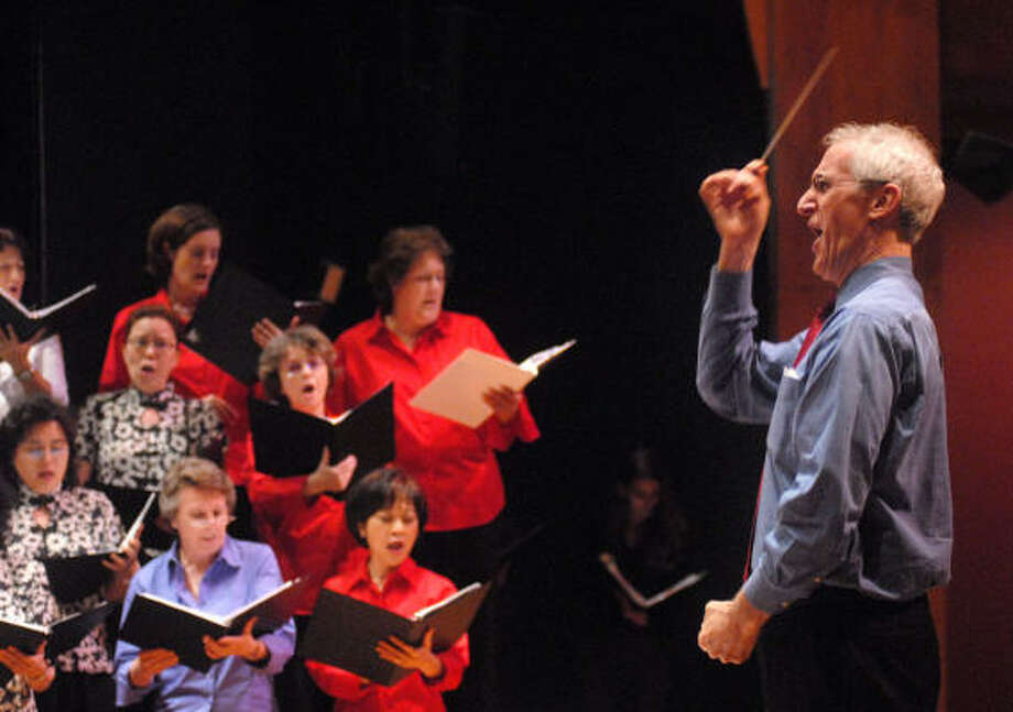 Phillip Kloeckner leads the United Nations Association International Choir during a rehearsal for the upcoming spring concert, Songs From Asia: Embracing the Eastern World. Photo: Dave Rossman, For The Chronicle