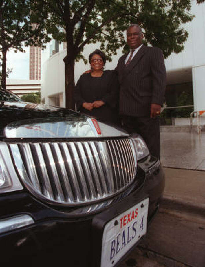 Bennie Beal, Jr. and his wife, Lillie, stand by their limo in front of the Enron building downtown in 1999. The couple launched Beal's Town Car and Limousine Service in 1992. Photo: John Everett, Chronicle File Photo