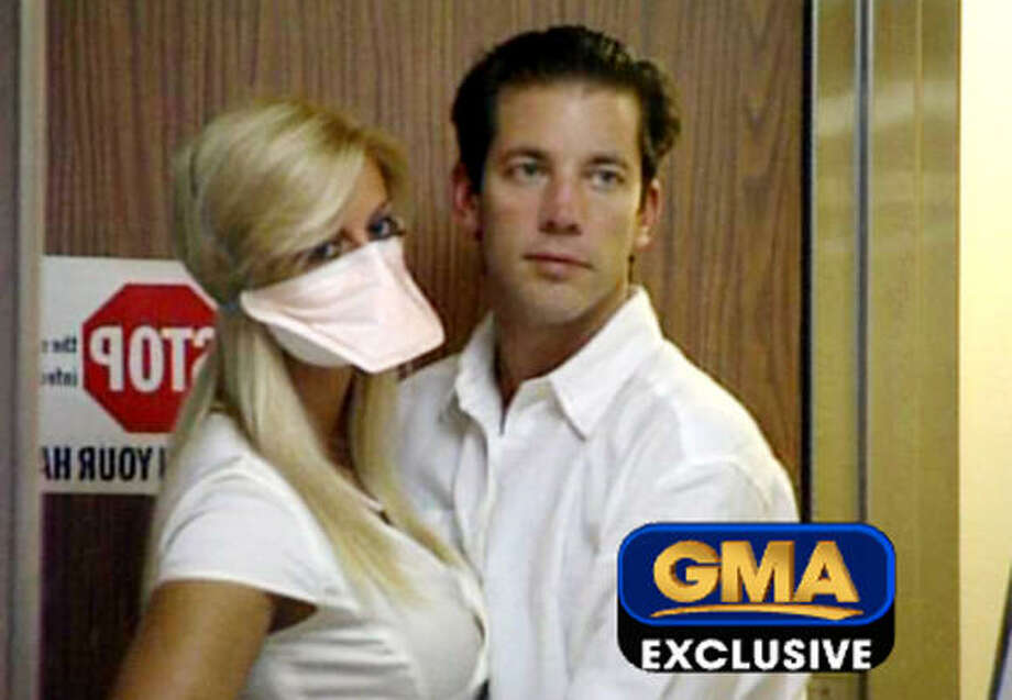 Andrew Speaker poses with his wife, Sarah, during a interview with Good Morning America's Diane Sawyer in an isolation room in a hospital in Denver, Colorado. Photo: -, AFP/Getty Images