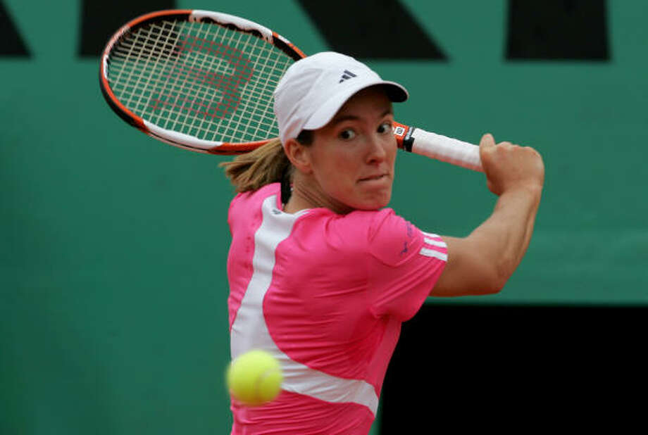 Justine Henin moves into the French Open semifinals with three other women who have never made it that far in Paris. Photo: Clive Rose, Getty Images
